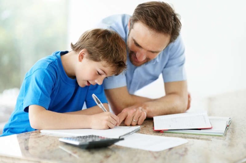 a father helps his son with homework, which positively impacts student success